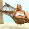 Attractive woman relaxing in a hammock — Stock Video #12815213