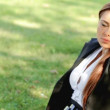 Beautiful business woman relaxing on grass with laptop — Stock Video #12892846