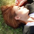 Beautiful business woman relaxing on grass — Stock Video #12892896