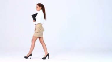Adorable business woman walks in and showing at blank copy space
