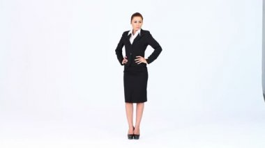 Young business woman standing at white background — Stock Video #12890114