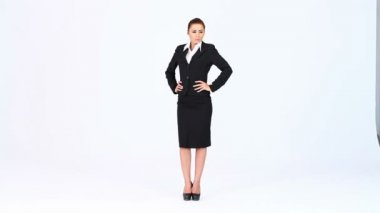 Young business woman standing at white background