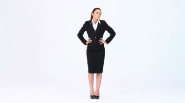 Young business woman standing at white background — Stock Video