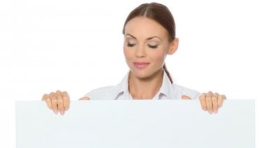 Beautiful business woman holding empty white board — Stock Video #12894410