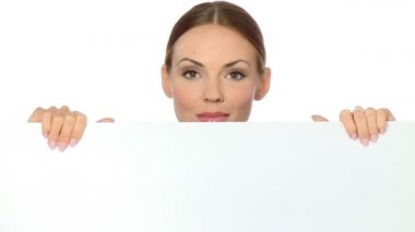 Beautiful business woman holding empty white board — Stock Video #12894416