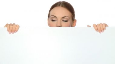 Beautiful business woman holding empty white board — Stock Video #12894417