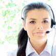 Beautiful young businesswoman talking phone with headset — Stock Video