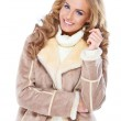 Cute woman wearing modern winter fur jacket — Stock Photo #13738567