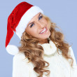 Smiling blond woman in Santa hat isolated — Stock Photo #13738572