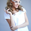 Portrait of a lovely young girl wearing stylish white glasses — Stock Photo
