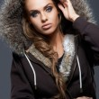 Close up of blond woman wearing hooded sweatshirt — Stock Photo #13738635