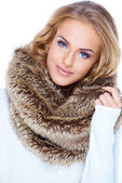 Gorgeous blond woman wearing fur scarf and smiling — Stock Photo