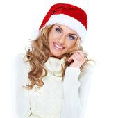 Noel baba şapkası giyen güzel bir kadın portresi — Stok fotoğraf