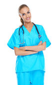 Young doctor holding her stethoscope around her neck — Stock Photo