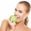 Beautiful young woman bites a green apple — Stock Photo #13863893