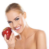 Cute young lady holding red apple — Stock Photo