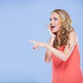 Young woman pointing her finger at something — Stock Photo