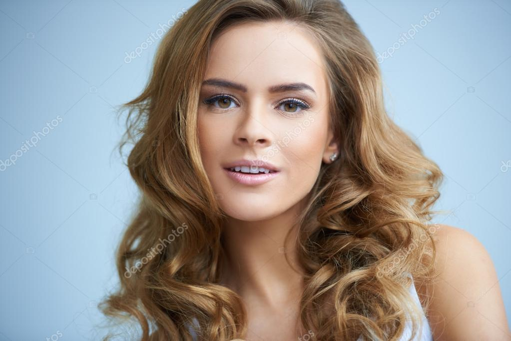 Close up portrait of gorgeous young woman on blue — Stock Photo #14088863