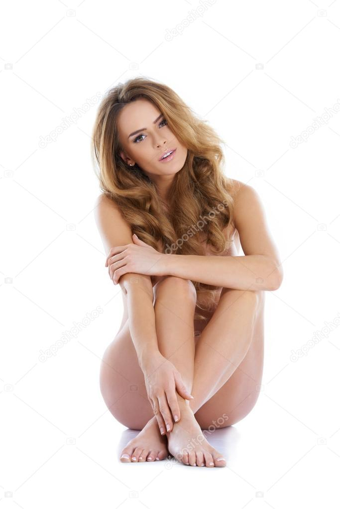 Portrait of a adorable young woman with a gorgeous figure, sitting isolated — Stock Photo #14088948
