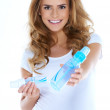 Cute young preganant woman with baby bottles — Stock Photo
