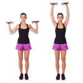 Woman working out with dumbbells in a gym — Stock Photo