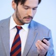 Man reading a text message on his mobile — Stock Photo #18521203