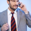 Businessman chatting on a mobile phone — Stock Photo