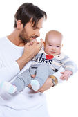 Young father cradling his baby on his arm — Stock Photo