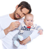 Proud young father posing with his baby — Stock Photo