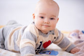 Contented little baby smiling at the camera — Stock Photo