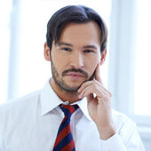 Thoughtful young businessman — Stock Photo
