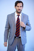 Handsome businessman in a grey suit — Stock Photo