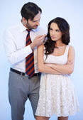 Attractive young Caucasian man tempting a woman — Stock Photo