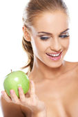 Happy woman with a crisp green apple — Stock Photo