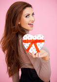 Vivacious woman with Valentine gift — Stock Photo