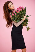 Sexy woman with Valentine roses — Stock Photo