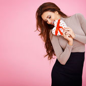 Sentimental woman with a Valentine gift — Stock Photo