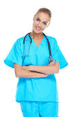 Smiling beautiful doctor in scrubs — Stock Photo