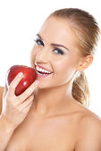 Laughing woman with a red apple — Stock Photo