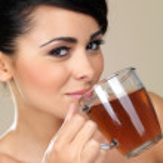 Attractive woman drinking tea — Stock Photo