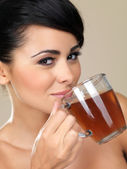 Attractive woman drinking tea — Stock Photo