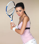 Attractive woman playing tennis — Stock Photo