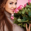 Beautiful seductive woman with roses — Stock Photo