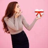 Beautiful woman blowing a kiss — Stock Photo