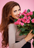 Laughing romantic woman with roses — Stok fotoğraf