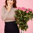 Surprised with flowers - Foto Stock