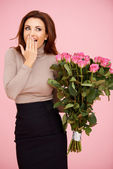 Surprised with flowers — Stockfoto