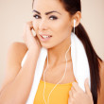 Portrait of sporty woman wearing headphones — Stock Photo