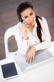 High angle shot of business woman sitting at the desk — Stock Photo