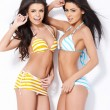 Two beautiful girls posing in swimsuits — Stock Photo